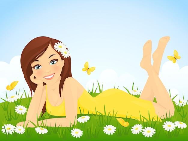 Linda garota deitada no prado de flores