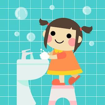 Linda garota está lavando as mãos no banheiro