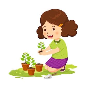 Linda garota feliz plantando árvores