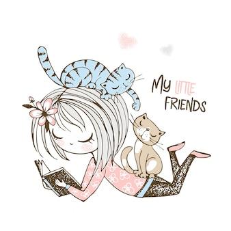 Linda garota lendo um livro na companhia de pequenos gatinhos.