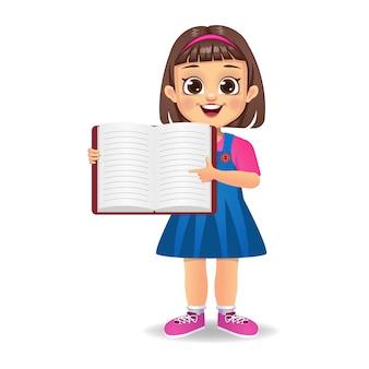 Linda garota mostrando o dedo indicador para um livro em branco
