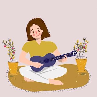 Linda garota tocar ukulele