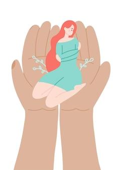 Linda mulher sentada de joelhos abraçando a si mesmo com mãos enormes apoiar o conceito de psicólogo