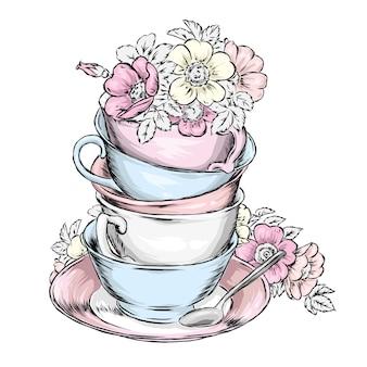 Lindas xícaras vintage e pires com um buquê de rosa selvagem.
