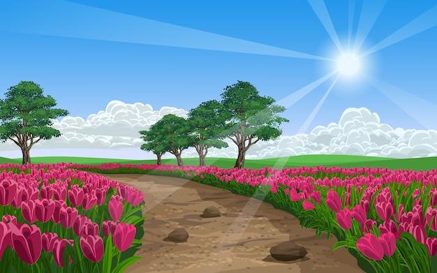 Lindo campo de flores com trilha e árvores