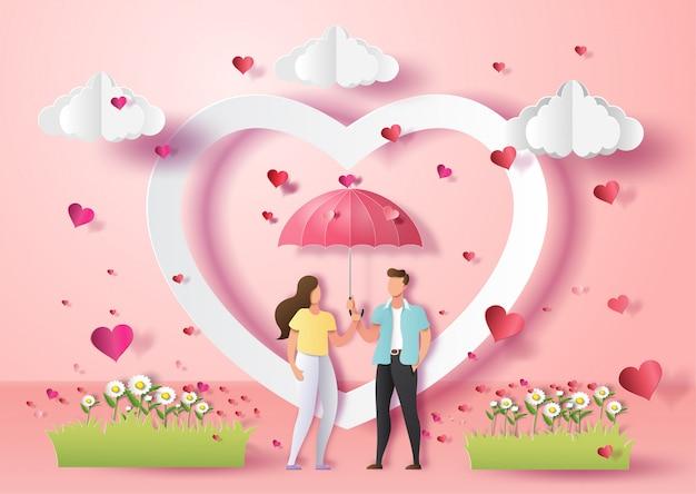 Lindo casal apaixonado, segurando o guarda-chuva com muitos corações.