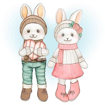 Lindo casal de coelhinhos em aquarela pastel com roupas de inverno