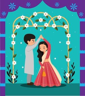 Lindo casal indiano dançando em um vestido tradicional de desenho animado