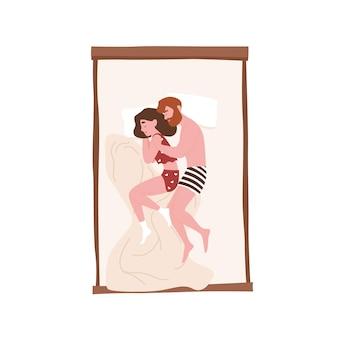 Lindo casal jovem, doce, deitado na cama, abraçando ou abraçando