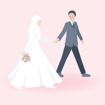 Lindo casal muçulmano em trajes de vestido e trajes de casamento, caminhando juntos e segurando a mão