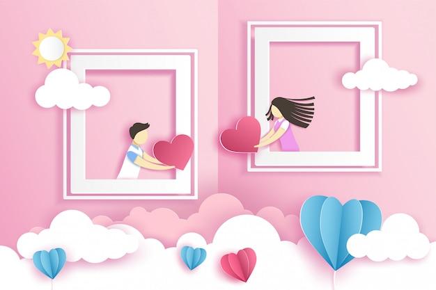 Lindo casal nas janelas com coração de origami no dia dos namorados com.