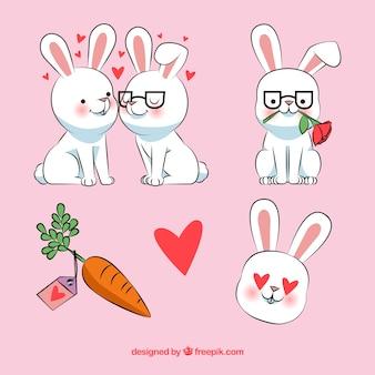 Lindo conjunto de mão desenhada coelhos amorosos