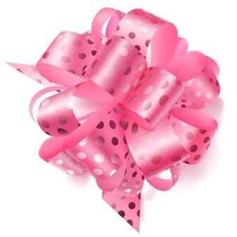 Lindo laço grande feito de fita rosa em bolinhas com sombra no fundo branco