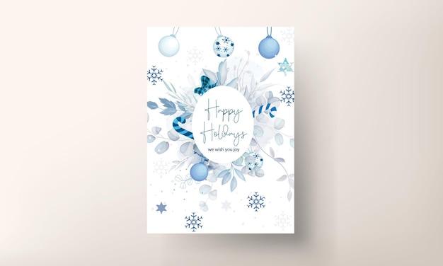 Lindo modelo de cartão de natal com enfeites de natal azuis e brancos