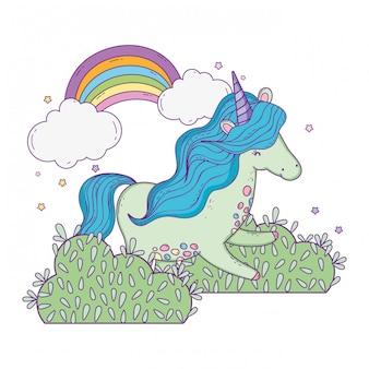 Lindo pequeno unicórnio com arco-íris na paisagem