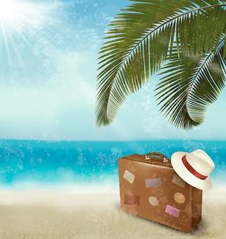 Lindo vintage à beira-mar com mala e chapéu