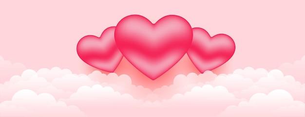 Lindos corações 3d sobre a bandeira das nuvens