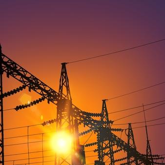 Linha de transmissão elétrica no pôr do sol.