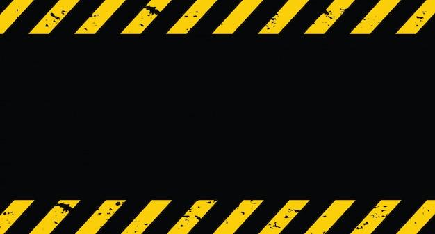 Linha preta e amarela listrada. sob o fundo do grunge de construção.