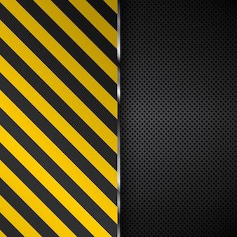 Listras amarelas e pretas em um fundo de metal perfurado