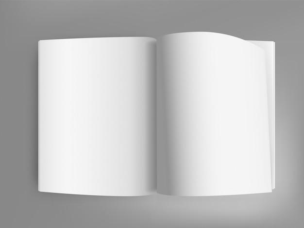Livro aberto branco na mesa cinza