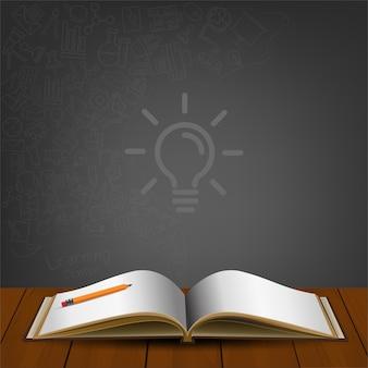 Livro aberto com rabiscos de ícone no fundo traseiro.