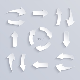 Livro branco corta setas conjunto com sombras.