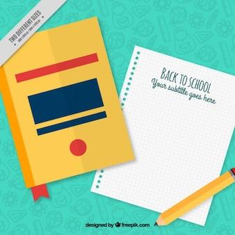 Livro com um caderno e lápis
