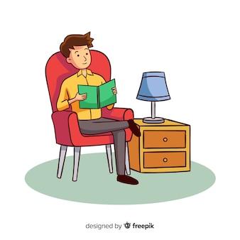 Livro de leitura do homem em sua poltrona