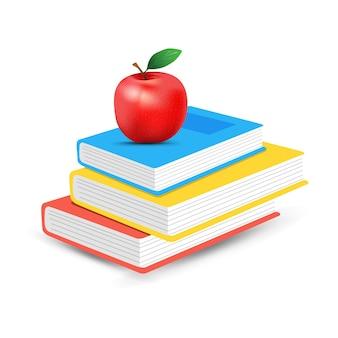 Livros com maçã no topo