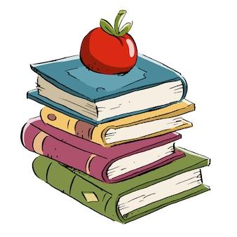 Livros com maçã por cima