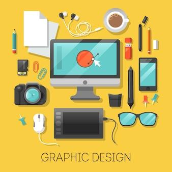 Local de trabalho de design gráfico com computador e ferramentas digitais.