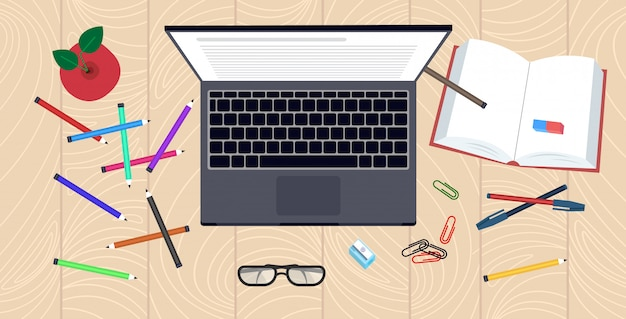 Local de trabalho mesa ângulo vista laptop livro e material de escritório conhecimento educação aprendizagem conceito horizontal