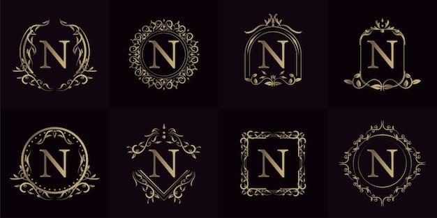 Logo inicial n com ornamento de luxo ou moldura de flor, coleção definida.