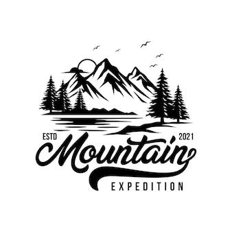 Logotipo da aventura na montanha