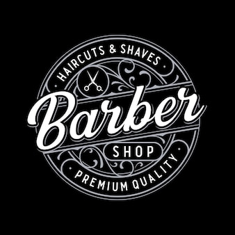 Logotipo da barbearia com letras vintage e ornamentos florais