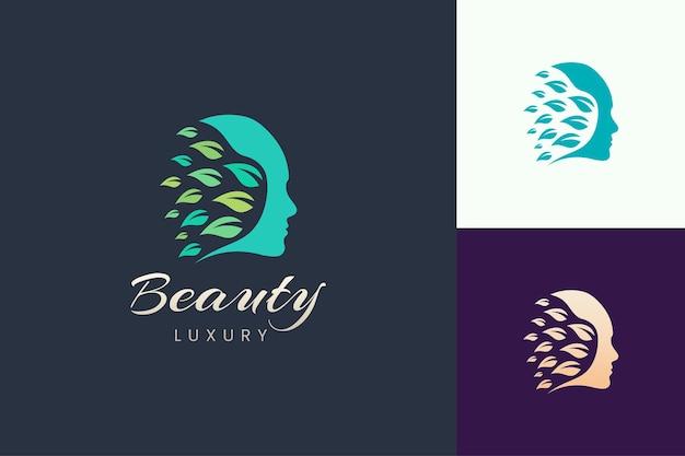 Logotipo da beleza com formato de rosto e folha para marca de cosméticos e cuidados com a pele
