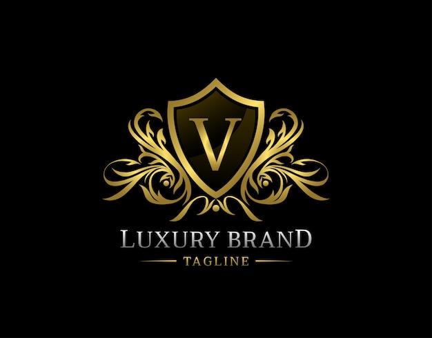Logotipo da carta v do escudo de luxo.