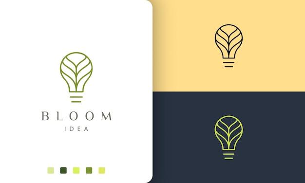 Logotipo da lâmpada verde em estilo simples e moderno