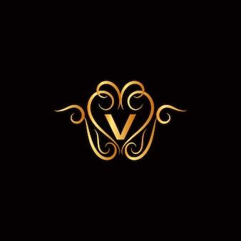 Logotipo da letra v com enfeites dourados