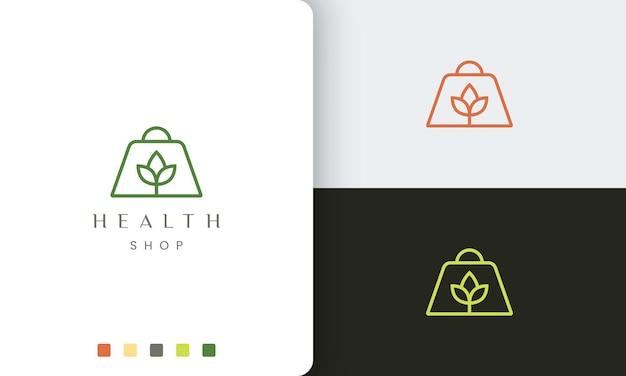 Logotipo da sacola de compras para loja natural ou orgânica em estilo simples e moderno