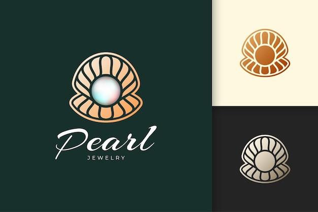 Logotipo de concha ou molusco luxuoso com joia de pérola para joias ou marcas de beleza