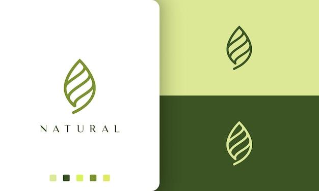 Logotipo de folha verde abstrato com estilo simples e moderno