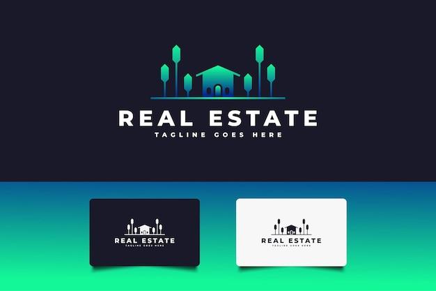 Logotipo de imóveis modernos em verde e azul. modelo de design de logotipo de construção, arquitetura ou edifício