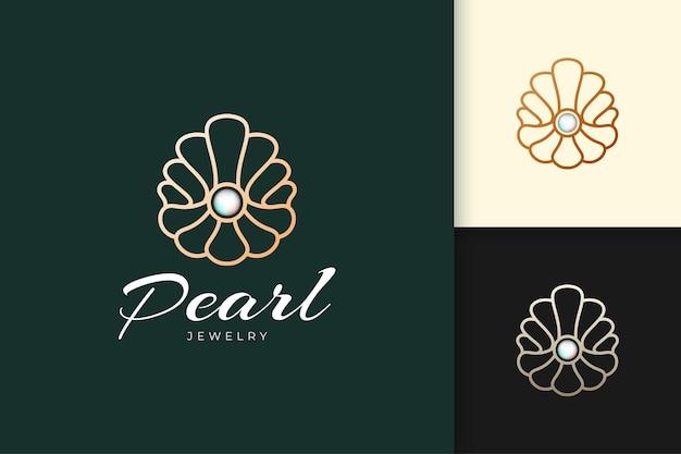 Logotipo de luxo e pérola de alta qualidade em forma de concha representam joia ou classe