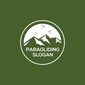 Logotipo de montanha em parapente