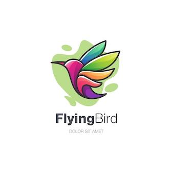 Logotipo de pássaro voador colorido abstrato