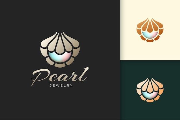 Logotipo de pérola de luxo com forma de concha ou marisco representam joias e pedras preciosas