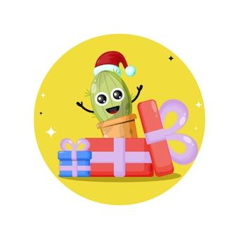 Logotipo de personagem fofa de presente de natal de cacto