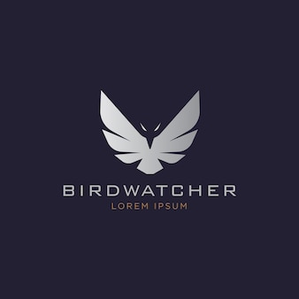 Logotipo de silhueta de águia voadora elegante